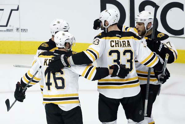 Boston Bruins left wing Milan Lucic, right, celebrates with his teammates after scoring his second goal during the second period of Game 1 in their NHL Stanley Cup Final hockey series against the Chicago Blackhawks, Wednesday, June 12, 2013 in Chicago. &#40;AP Photo&#47;Charles Rex Arbogast&#41; <span class=meta>(AP Photo&#47; Charles Rex Arbogast)</span>