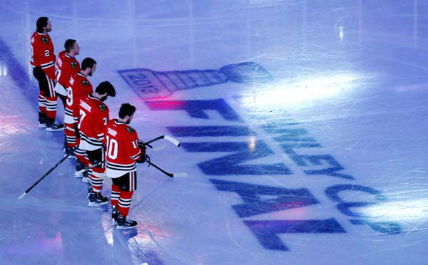 Chicago Blackhawks players line up during the national anthem before Game 1 in their NHL Stanley Cup Final hockey series against the Boston Bruins,Wednesday, June 12, 2013 in Chicago. &#40;AP Photo&#47;Charles Rex Arbogast&#41; <span class=meta>(AP Photo&#47; Charles Rex Arbogast)</span>