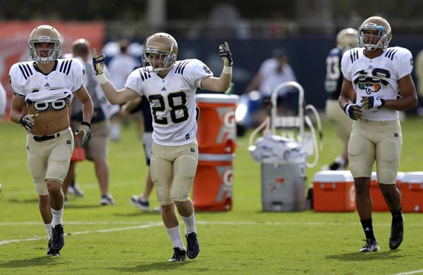 Notre Dame safety Austin Collinsworth (28) gestures as he and teammates prepare to run more drills during practice, Thursday, Jan. 3, 2013, at the Miami Dolphins' training facility in Davie, Fla. Notre Dame is scheduled to play Alabama on Monday, Jan. 7, in the BCS national championship NCAA college football game. (AP Photo/Wilfredo Lee)