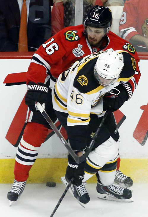 Boston Bruins center David Krejci &#40;46&#41; and Chicago Blackhawks center Marcus Kruger &#40;16&#41; battle for the control of the puck during the second period of Game 1 in their NHL Stanley Cup Final hockey series on Wednesday, June 12, 2013, in Chicago. &#40;AP Photo&#47;Charles Rex Arbogast&#41; <span class=meta>(AP Photo&#47; Charles Rex Arbogast)</span>