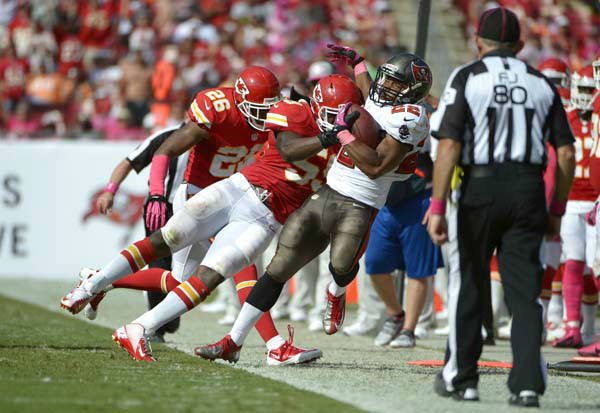 Tampa Bay Buccaneers running back Doug Martin &#40;22&#41; is knocked out of bounds by Kansas City Chiefs inside linebacker Jovan Belcher &#40;59&#41; and cornerback Stanford Routt &#40;26&#41; after running for a 23-yard gain during the second half of an NFL football game in Tampa, Fla., Sunday, Oct. 14, 2012.&#40;AP Photo&#47;Phelan M. Ebenhack&#41; <span class=meta>(AP Photo&#47; Phelan M. Ebenhack)</span>