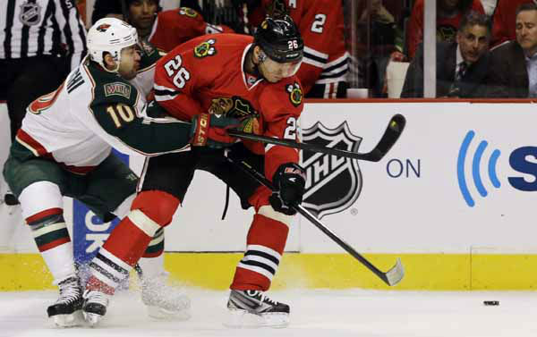 Minnesota Wild&#39;s Devin Setoguchi, left, battles for the puck with Chicago Blackhawks&#39; Michal Handzus during the first period of Game 2 of an NHL hockey Stanley Cup first-round playoff series in Chicago, Friday, May 3, 2013. &#40;AP Photo&#47;Nam Y. Huh&#41; <span class=meta>(AP Photo&#47; Nam Y. Huh)</span>