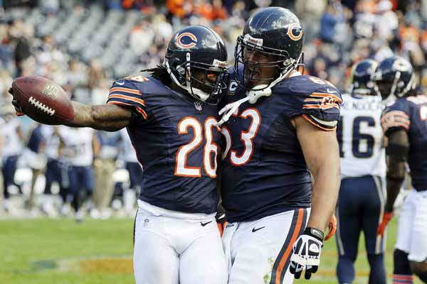 Chicago Bears cornerback Tim Jennings &#40;26&#41; celebrates with center Roberto Garza &#40;63&#41; in the second half of an NFL football game in Chicago, Sunday, Sept. 23, 2012. The Bears won 23-6. &#40;AP Photo&#47;Nam Y. Huh&#41; <span class=meta>(AP Photo&#47; Nam Y. Huh)</span>