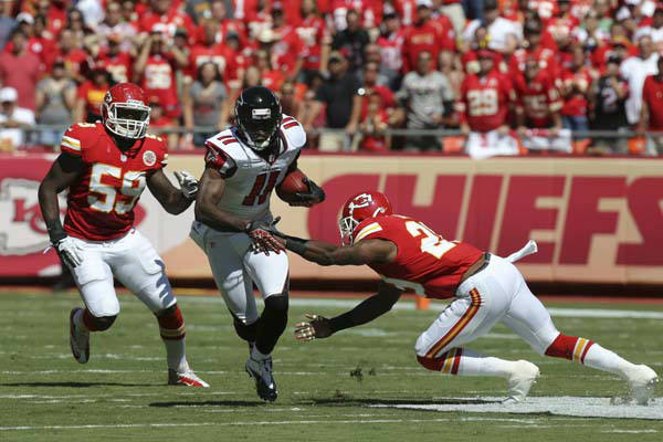 Atlanta Falcons wide receiver Julio Jones &#40;11&#41; breaks between Kansas City Chiefs linebacker Jovan Belcher &#40;59&#41; and strong safety Eric Berry &#40;29&#41; during the first half of an NFL football game at Arrowhead Stadium in Kansas City, Mo., Sunday, Sept. 9, 2012. &#40;AP Photo&#47;Ed Zurga&#41; <span class=meta>(AP Photo&#47; Ed Zurga)</span>