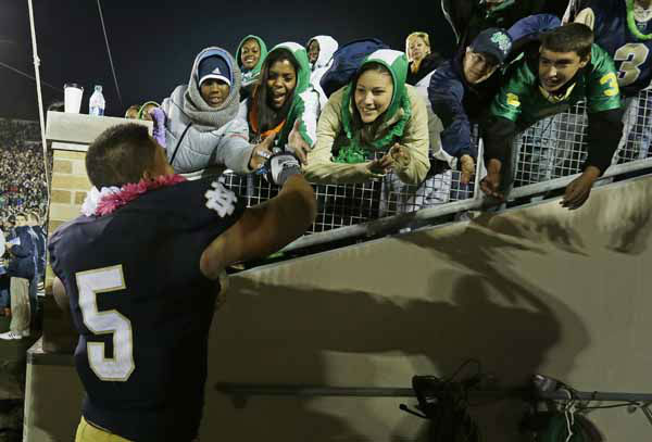 "<div class=""meta image-caption""><div class=""origin-logo origin-image ""><span></span></div><span class=""caption-text"">In this Sept. 22, 2012 photo,  Notre Dame's Manti Te'o (5) celebrates with fans after Notre Dame defeated Michigan, 13-6, in an NCAA college football game in South Bend, Ind. Notre Dame defensive coordinator Bob Diaco believes Te?o is the finest football player in college. (AP Photo/Darron Cummings) (AP Photo/ Darron Cummings)</span></div>"