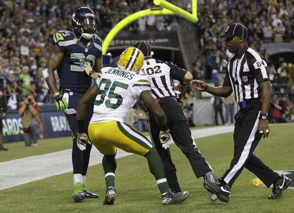 Officials separate Seattle Seahawks Brandon Browner &#40;39&#41; and Green Bay Packers Greg Jennings in the second half of an NFL football game, Monday, Sept. 24, 2012, in Seattle. &#40;AP Photo&#47;Ted S. Warren&#41; <span class=meta>(AP Photo&#47; Ted S. Warren)</span>