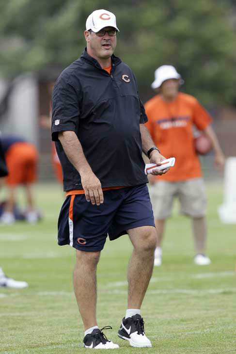 Chicago Bears offensive coordinator Mike Tice watches his team practice during NFL football training camp at Olivet Nazarene University in Bourbonnais, Ill., Thursday, July 26, 2012. &#40;AP Photo&#47;Nam Y. Huh&#41; <span class=meta>(AP Photo&#47; Nam Y. Huh)</span>