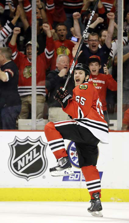 Chicago Blackhawks center Andrew Shaw &#40;65&#41; celebrates after scoring the winning goal during the third overtime period of Game 1 in their NHL Stanley Cup Final hockey series against the Boston Bruins, Thursday, June 13, 2013, in Chicago. &#40;AP Photo&#47;Nam Y. Huh&#41; <span class=meta>(AP Photo&#47; Nam Y. Huh)</span>