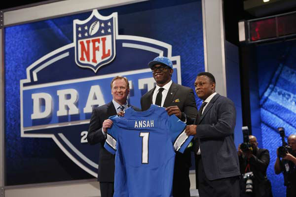 Ezekiel Ansah, from Brigham Young, stands with NFL Commissioner Roger Goodell, left, and Barry Sanders after being selected fifth overall by the Detroit Lions in the first round of the NFL football draft, Thursday, April 25, 2013, at Radio City Music Hall in New York. &#40;AP Photo&#47;Jason DeCrow&#41; <span class=meta>(AP Photo&#47; Jason DeCrow)</span>