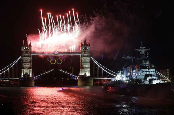 Fireworks illuminate the sky over the Tower Bridge and River Thames in London during the Opening Ceremony at the 2012 Summer Olympics, Friday, July 27, 2012, in London. &#40;AP Photo&#47;Lefteris Pitarakis&#41; <span class=meta>(AP Photo&#47; Lefteris Pitarakis)</span>