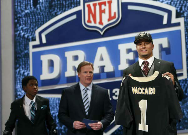 Safety Kenny Vaccaro, right, from Texas, stands with NFL commissioner Roger Goodell, center, and Markell Gregoire, 13, a patient at St. Jude Children&#39;s Research Hospital, after Vaccaro was selected 15th overall by the New Orleans Saints in the first round of the NFL football draft, Thursday, April 25, 2013 at Radio City Music Hall in New York.  &#40;AP Photo&#47;Jason DeCrow&#41; <span class=meta>(AP Photo&#47; Jason DeCrow)</span>