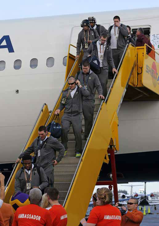 Notre Dame players deplane after arriving in Fort Lauderdale, Fla., Wednesday, Jan. 2, 2013. Notre Dame takes on Alabama in the BCS national championship NCAA college football game next Monday in Miami. &#40;AP Photo&#47;Alan Diaz&#41; <span class=meta>(AP)</span>