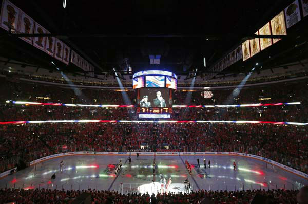 "<div class=""meta image-caption""><div class=""origin-logo origin-image ""><span></span></div><span class=""caption-text"">Fans cheer during the performance of the national anthem before Game 1 of the NHL Stanley Cup Final hockey series between the Chicago Blackhawks and the Boston Bruins on Wednesday, June 12, 2013 in Chicago. (AP Photo/Charles Rex Arbogast) (AP Photo/ Charles Rex Arbogast)</span></div>"