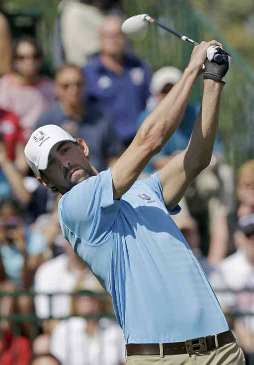 Olympic gold medalist Michael Phelps hits a drive on the first hole during a celebrity scramble event at the Ryder Cup PGA golf tournament Tuesday, Sept. 25, 2012, at the Medinah Country Club in Medinah, Ill. &#40;AP Photo&#47;David J. Phillip&#41; <span class=meta>(AP Photo&#47; David J. Phillip)</span>