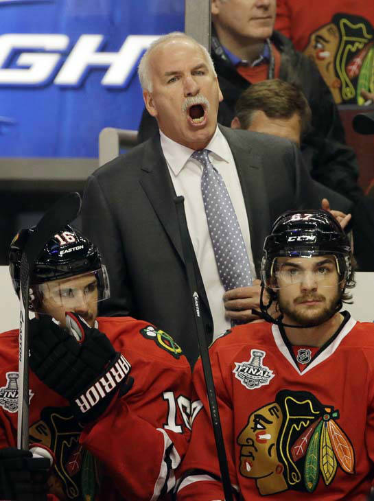 Chicago Blackhawks head coach Joel Quenneville directs his team during the second period of Game 1 in their NHL Stanley Cup Final hockey series against the Boston Bruins, Wednesday, June 12, 2013, in Chicago. &#40;AP Photo&#47;Nam Y. Huh&#41; <span class=meta>(AP Photo&#47; Nam Y. Huh)</span>