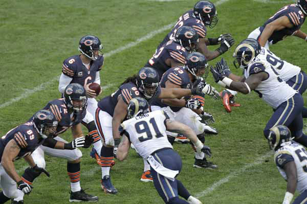 Chicago Bears quarterback Jay Cutler &#40;6&#41; takes a snap at the line of scrimmage in the second half of an NFL football game against the St. Louis Rams in Chicago, Sunday, Sept. 23, 2012. &#40;AP Photo&#47;Kiichiro Sato&#41; <span class=meta>(AP Photo&#47; Kiichiro Sato)</span>