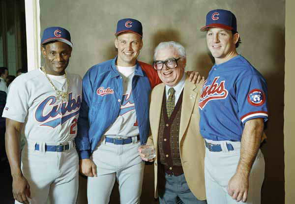 Harry Caray, center right, poses with Chicago Cub&#39;s outfielder Sammy Sosa, left, first baseman Mark Grace, center left, and catcher Rick Wilkins, right, at the opening ceremonies of the Ninth Annual Cubs Fan Convention, Friday, Feb. 11, 1994 in Chicago. The Chicago Cubs unveiled their new road uniforms for the 1994 season at the convention and also paid tribute to Caray as he begins his 50th year as a major league broadcaster. &#40;AP Photo&#47;John Swart&#41; <span class=meta>(AP Photo&#47; John Swart)</span>