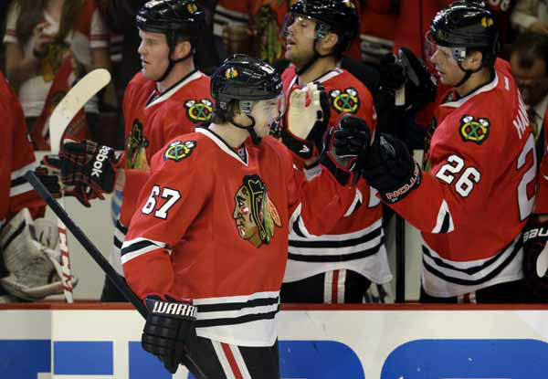 "<div class=""meta ""><span class=""caption-text "">Chicago Blackhawks' Michael Frolik (67) celebrates with teammates after scoring a goal during the first period of Game 2 of an NHL hockey Stanley Cup first-round playoff series against the Minnesota Wild in Chicago, Friday, May 3, 2013. (AP Photo/Nam Y. Huh) (AP Photo/ Nam Y. Huh)</span></div>"