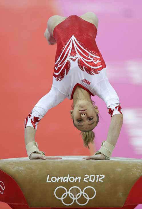 Russian gymnast Victoria Komova performs on the vault during the Artistic Gymnastic women&#39;s team final at the 2012 Summer Olympics, Tuesday, July 31, 2012, in London. &#40;AP Photo&#47;Gregory Bull&#41; <span class=meta>(AP Photo&#47; Gregory Bull)</span>