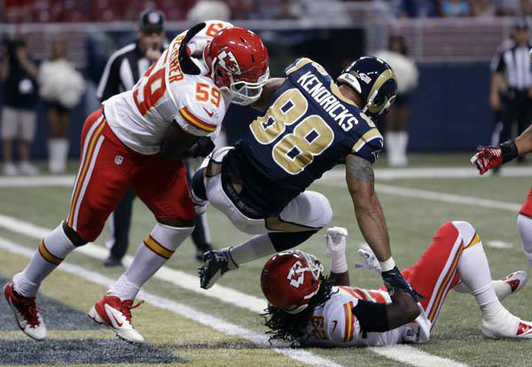 St. Louis Rams tight end Lance Kendricks &#40;88&#41; falls into the end zone past Kansas City Chiefs linebacker Jovan Belcher, left, and defensive back Kendrick Lewis after catching a 23-yard touchdown pass during the first quarter of a preseason NFL football game on Saturday, Aug. 18, 2012, in St. Louis. &#40;AP Photo&#47;Jeff Roberson&#41; <span class=meta>(AP Photo&#47; Jeff Roberson)</span>