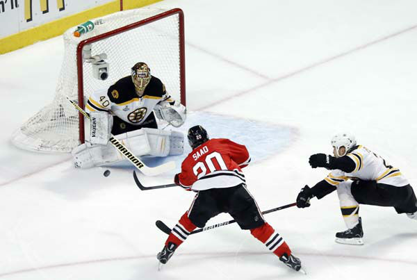 Boston Bruins goalie Tuukka Rask &#40;40&#41; saves a shot by Chicago Blackhawks left wing Brandon Saad &#40;20&#41; during the first period of Game 1 in their NHL Stanley Cup Final hockey series,Wednesday, June 12, 2013 in Chicago. &#40;AP Photo&#47;Charles Rex Arbogast&#41; <span class=meta>(AP Photo&#47; Charles Rex Arbogast)</span>