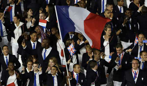 France&#39;s Laura Flessel-Colovic carries the flag during the Opening Ceremony at the 2012 Summer Olympics, Friday, July 27, 2012, in London. &#40;AP Photo&#47;Paul Sancya&#41; <span class=meta>(AP Photo&#47; Paul Sancya)</span>