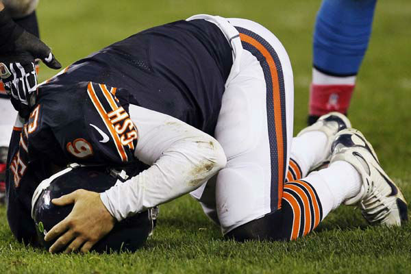 Chicago Bears quarterback Jay Cutler &#40;6&#41; holds his head after being sacked by Detroit Lions defensive tackle Ndamukong Suh in the first half of an NFL football game in Chicago, Monday, Oct. 22, 2012. &#40;AP Photo&#47;Charles Rex Arbogast&#41; <span class=meta>(AP Photo&#47; Charles Rex Arbogast)</span>