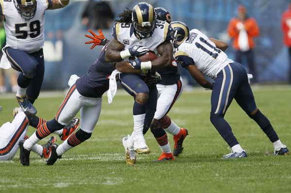 St. Louis Rams running back Steven Jackson &#40;39&#41; gets tackled by Chicago Bears free safety Chris Conte, left, in the second half of an NFL football game in Chicago, Sunday, Sept. 23, 2012. &#40;AP Photo&#47;Charles Rex Arbogast&#41; <span class=meta>(AP Photo&#47; Charles Rex Arbogast)</span>
