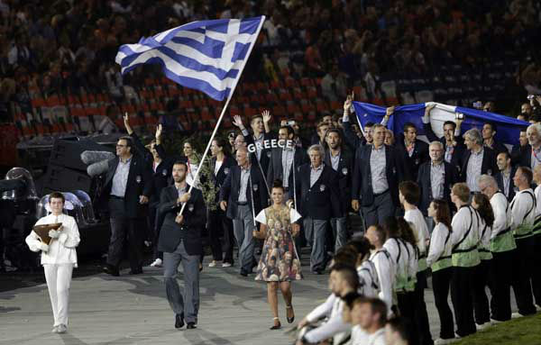 Greece&#39;s Alexandros Nikolaidis carries his national flag during the Opening Ceremony at the 2012 Summer Olympics, Friday, July 27, 2012, in London. &#40;AP Photo&#47;Mark Humphrey&#41; <span class=meta>(AP Photo&#47; Mark Humphrey)</span>