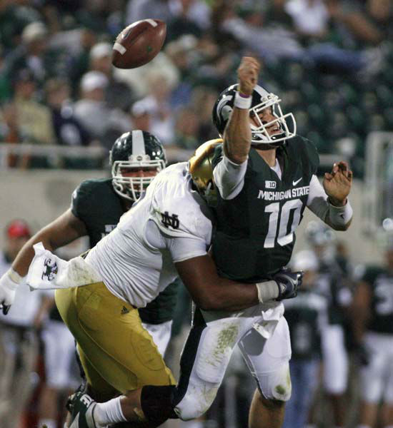 Michigan State quarterback Andrew Maxwell &#40;10&#41; fumbles the ball as he is hit by Notre Dame&#39;s T.J. Jones during the fourth quarter of an NCAA college football game, Saturday, Sept. 15, 2012, in East Lansing, Mich. Michigan State recovered the fumble. Notre Dame won 20-3. &#40;AP Photo&#47;Al Goldis&#41; <span class=meta>(AP Photo&#47; Al Goldis)</span>