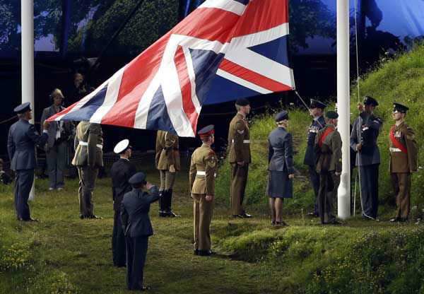 The British flag is raised up during the Opening Ceremony at the 2012 Summer Olympics, Friday, July 27, 2012, in London. &#40;AP Photo&#47;Paul Sancya&#41; <span class=meta>(AP Photo&#47; Paul Sancya)</span>