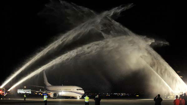 A plane carrying the Stanley Cup winning Chicago Blackhawks hockey team is welcomed with water cannons after arriving at O&#39;Hare International Airport in Chicago, on Tuesday, June 25, 2013. &#40;AP Photo&#47;Paul Beaty&#41; <span class=meta>(AP Photo&#47; PAUL BEATY)</span>