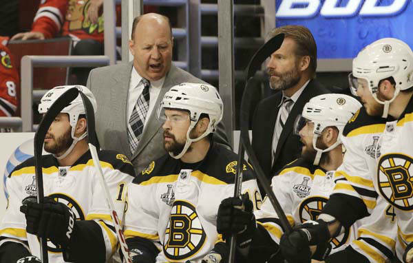Boston Bruins head coach Claude Julien talks to his team during the first period of Game 1 in their NHL Stanley Cup Final hockey series against the Chicago Blackhawks, Wednesday, June 12, 2013, in Chicago. &#40;AP Photo&#47;Nam Y. Huh&#41; <span class=meta>(AP Photo&#47; Nam Y. Huh)</span>