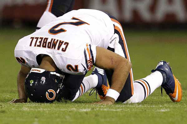 Chicago Bears quarterback Jason Campbell &#40;2&#41; gets off the ground after being tackled during the second half of an NFL football game against the San Francisco 49ers in San Francisco, Monday, Nov. 19, 2012. &#40;AP Photo&#47;Tony Avelar&#41; <span class=meta>(AP Photo&#47; Tony Avelar)</span>