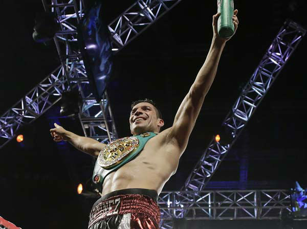 Sergio Martinez waves to the crowd after defeating Julio Cesar Chavez Jr. for the WBC middleweight title, Saturday, Sept. 15, 2012, in Las Vegas. Martinez won by unanimous decision. &#40;AP Photo&#47;Julie Jacobson&#41; <span class=meta>(AP Photo&#47; Julie Jacobson)</span>
