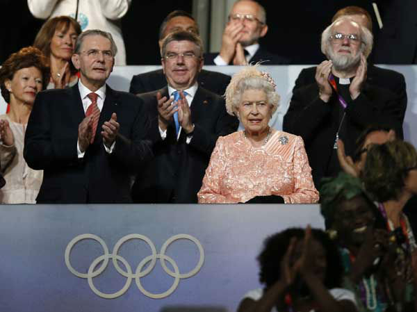 Britain&#39;s Queen Elizabeth II, center, the President of the International Olympic Committee Jacques Rogge, left, and Britain&#39;s Archbishop of Canterbury Rowan Williams, right, watch the Opening Ceremony at the 2012 Summer Olympics, Friday, July 27, 2012, in London. &#40;AP Photo&#47;Matt Dunham&#41; <span class=meta>(AP Photo&#47; Matt Dunham)</span>