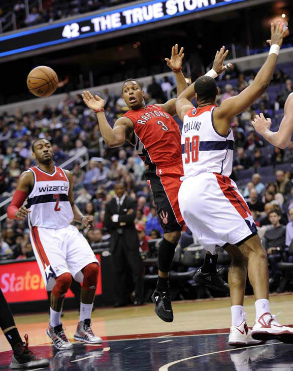 Toronto Raptors guard Kyle Lowry &#40;3&#41; passes the ball against Washington Wizards&#39; John Wall &#40;2&#41; and Jason Collins &#40;98&#41; during the first half of an NBA basketball game, Sunday, March 31, 2013, in Washington. &#40;AP Photo&#47;Nick Wass&#41; <span class=meta>(AP Photo&#47; Nick Wass)</span>