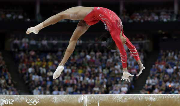 "<div class=""meta image-caption""><div class=""origin-logo origin-image ""><span></span></div><span class=""caption-text"">U.S. gymnast Gabrielle Douglas performs on the balance beam during the Artistic Gymnastics women's team final at the 2012 Summer Olympics, Tuesday, July 31, 2012, in London. (AP Photo/Julie Jacobson) (AP Photo/ Julie Jacobson)</span></div>"
