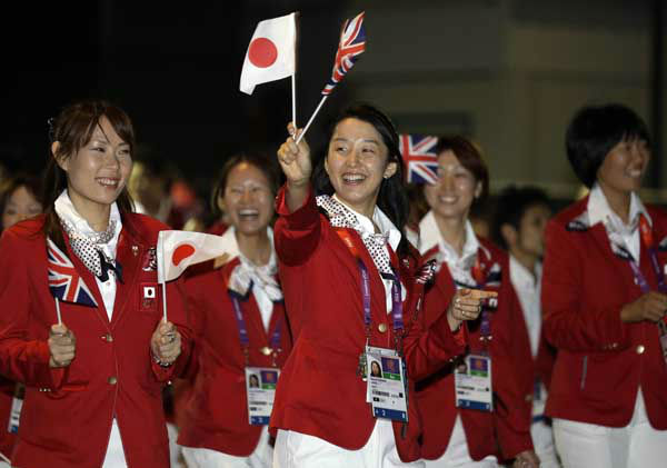 Members of the Japanese Olympic team wave flags as they walk toward the Olympic Park during the Opening Ceremony at the 2012 Summer Olympics, Friday, July 27, 2012, in London. &#40;AP Photo&#47;Julio Cortez&#41; <span class=meta>(AP Photo&#47; Julio Cortez)</span>
