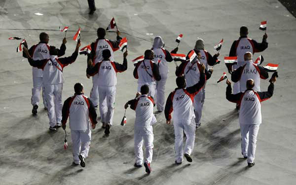 Iraq&#39;s Olympic team circle the stadium during the Opening Ceremony at the 2012 Summer Olympics, Friday, July 27, 2012, in London. &#40;AP Photo&#47;Charlie Riedel&#41; <span class=meta>(AP Photo&#47; Charlie Riedel)</span>
