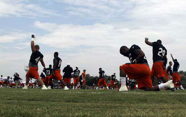 Chicago Bears players stretch during NFL football training camp at Olivet Nazarene University in Bourbonnais, Ill., Thursday, July 26, 2012. &#40;AP Photo&#47;Nam Y. Huh&#41; <span class=meta>(AP Photo&#47; Nam Y. Huh)</span>