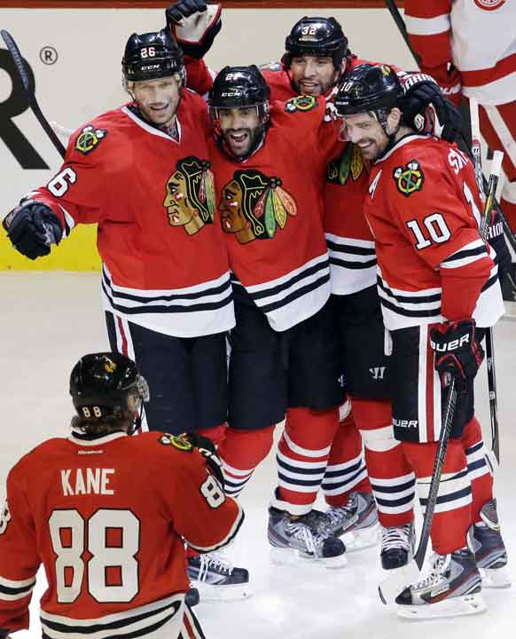 "<div class=""meta ""><span class=""caption-text "">Chicago Blackhawks' Johnny Oduya (27), second from left, celebrates with Michal Handzus (26), Michal Rozsival (32), Patrick Sharp (10) and Patrick Kane (88) after scoring his goal during the third period of Game 1 of an NHL hockey playoffs Western Conference semifinal against the Detroit Red Wings in Chicago, Wednesday, May 15, 2013. (AP Photo/Nam Y. Huh)</span></div>"