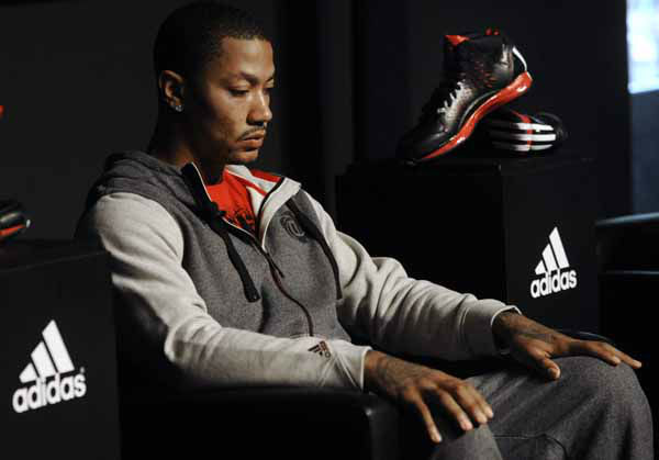 Chicago Bulls player Derrick Rose looks on during a press conference while unveiling his new shoe the Adidas D Rose 3 in Chicago, Thursday, Sept. 13, 2012. &#40;AP Photo&#47;Paul Beaty&#41; <span class=meta>(AP Photo&#47; PAUL BEATY)</span>