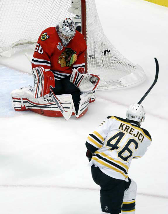 Chicago Blackhawks goalie Corey Crawford &#40;50&#41; makes a save on a shot by Boston Bruins center David Krejci &#40;46&#41; during the first period of Game 1 in their NHL Stanley Cup Final hockey series,Wednesday, June 12, 2013 in Chicago. &#40;AP Photo&#47;Charles Rex Arbogast&#41; <span class=meta>(AP Photo&#47; Charles Rex Arbogast)</span>