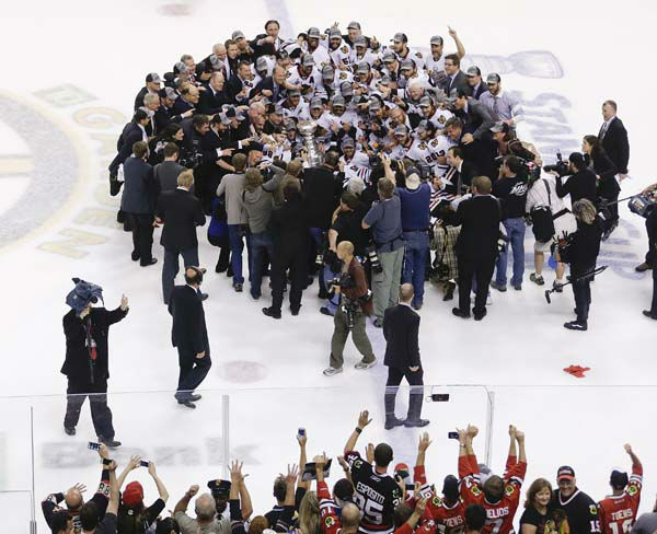 The Chicago Blackhawks pose with the Stanley Cup after beating the Boston Bruins 3-2 in Game 6 of the NHL hockey Stanley Cup Finals, Monday, June 24, 2013, in Boston. &#40;AP Photo&#47;Charles Krupa&#41; <span class=meta>(AP Photo&#47; Charles Krupa)</span>