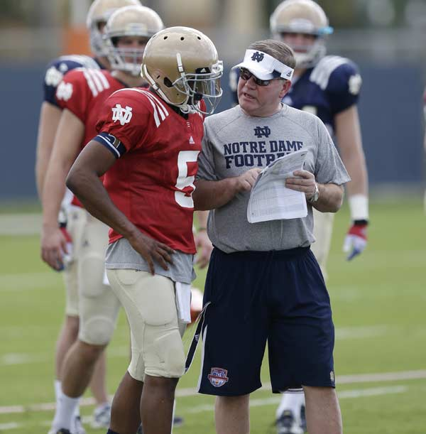 "<div class=""meta ""><span class=""caption-text "">Notre Dame head coach Brian Kelly, right, talks with quarterback Everett Golson during practice, Thursday, Jan. 3, 2013, at the Miami Dolphins' training facility in Davie, Fla. Notre Dame is scheduled to play Alabama on Monday, Jan. 7, in the BCS national championship NCAA college football game. (AP Photo/Wilfredo Lee)</span></div>"