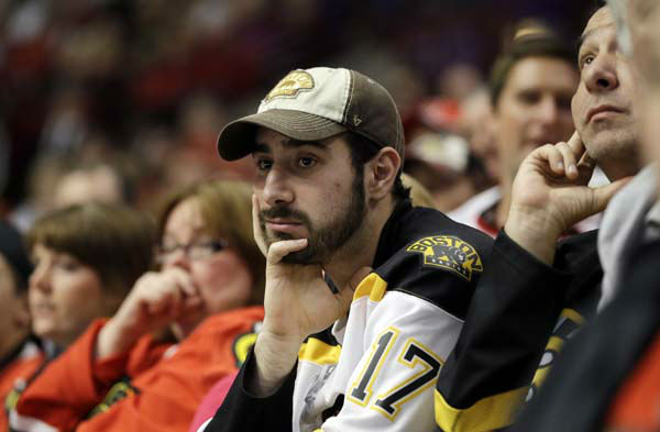 "<div class=""meta image-caption""><div class=""origin-logo origin-image ""><span></span></div><span class=""caption-text"">Fans watch during the second overtime period of Game 1 in their NHL Stanley Cup Final hockey series between the Chicago Blackhawks and the Boston Bruins, Wednesday, June 12, 2013, in Chicago. (AP Photo/Nam Y. Huh) (AP Photo/ Nam Y. Huh)</span></div>"