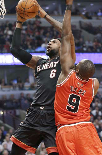 Miami Heat forward LeBron James, left, shoots in front of Chicago Bulls forward Luol Deng during the first half of an NBA basketball game in Chicago on Wednesday, March 27, 2013. &#40;AP Photo&#47;Nam Y. Huh&#41; <span class=meta>(AP Photo&#47; Nam Y. Huh)</span>