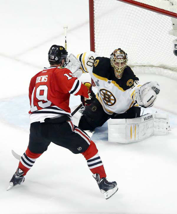 Boston Bruins goalie Tuukka Rask &#40;40&#41; makes a glove-save as Chicago Blackhawks center Jonathan Toews &#40;19&#41; waits for a rebound during the second period of Game 1 in their NHL Stanley Cup Final hockey series on Wednesday, June 12, 2013, in Chicago. &#40;AP Photo&#47;Charles Rex Arbogast&#41; <span class=meta>(AP Photo&#47; Charles Rex Arbogast)</span>