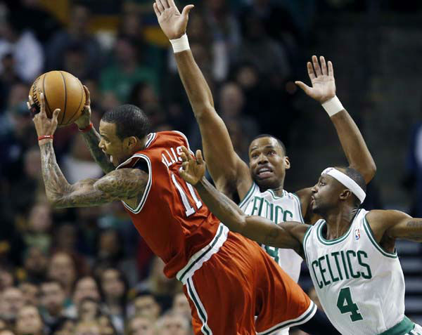 Boston Celtics&#39; Jason Collins, center, fouls Milwaukee Bucks&#39; Monta Ellis &#40;11&#41; as the Celtics&#39; Jason Terry &#40;4&#41; defends in the second quarter of an NBA basketball game in Boston, Friday, Dec. 21, 2012. &#40;AP Photo&#47;Michael Dwyer&#41; <span class=meta>(AP Photo&#47; Michael Dwyer)</span>